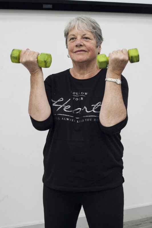 Woman holding up hand weights