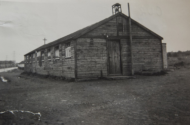 Black and white photo of a large wooden hut