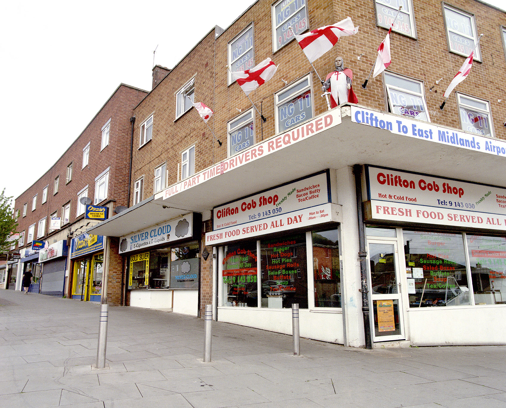 Image of a row of shops with a chip shop in the foreground