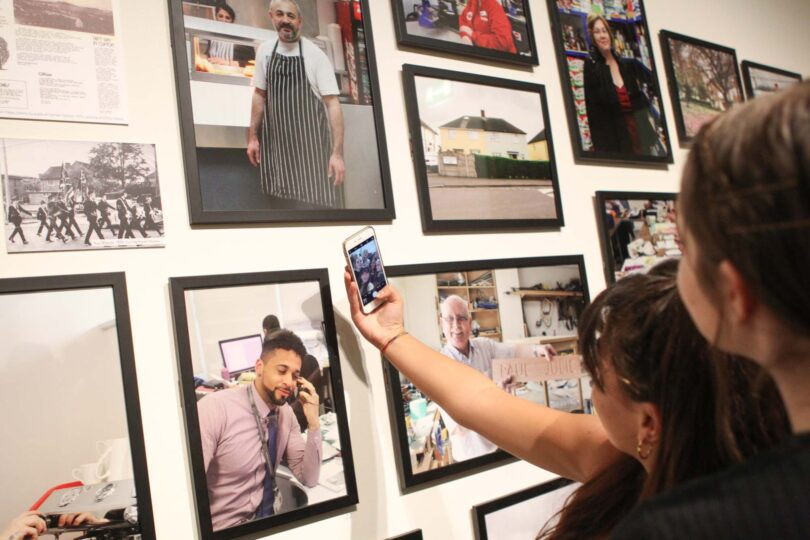 Students taking selfies in front of work at the National Portrait Gallery